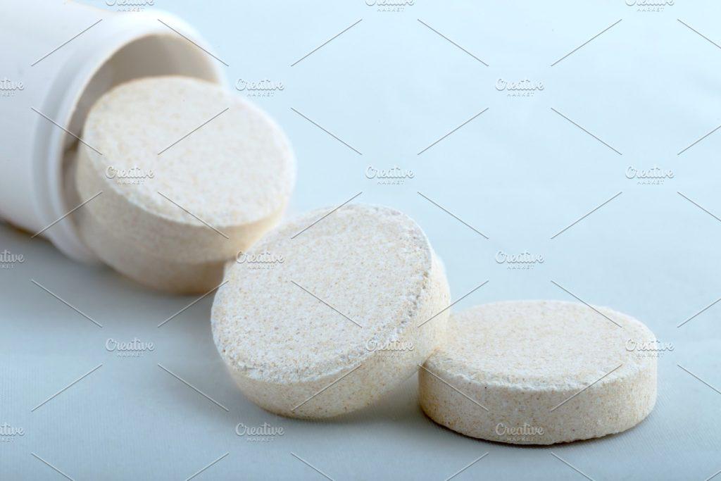 Effervescent pills on a blue backgro