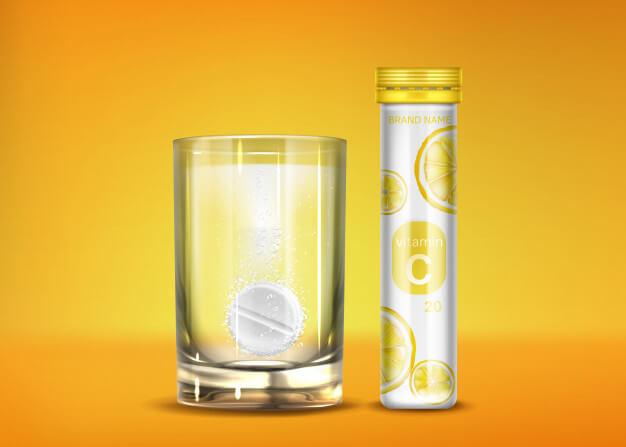 Effervescent vitamin c pills with fizz bubbles Free Vector