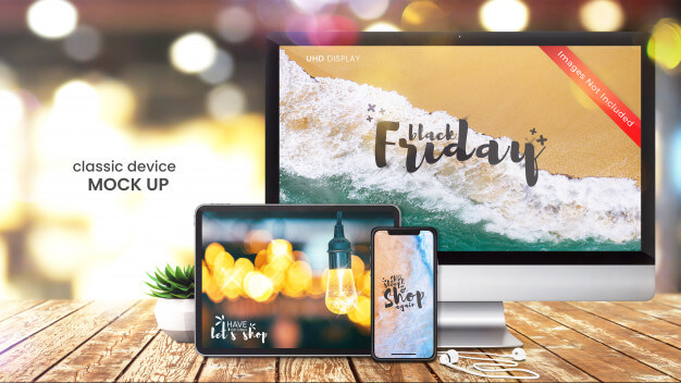 Pixel perfect mockup of computer screen, smartphone and digital tablet on bright shop table Premium Psd