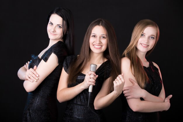 Girls music band with microphone Free Photo