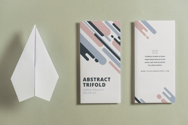 Closed trifold brochure mockup with paper plane Free Psd (1)