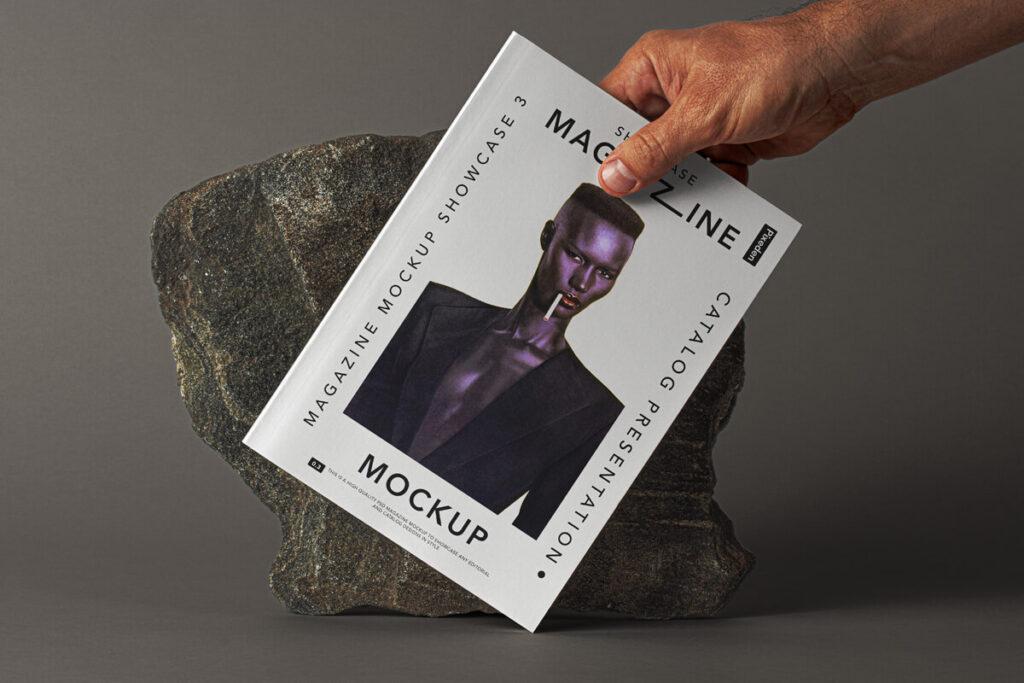 Free Hand Holding Magazine Mockup PSD Template1