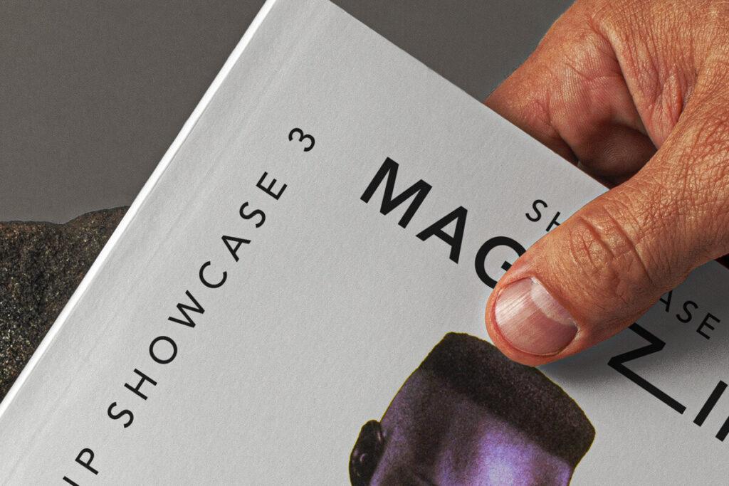 Free Hand Holding Magazine Mockup PSD Template2