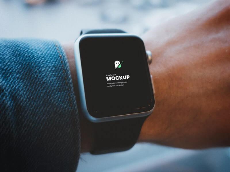 Free Smartwatch On Hand Mockup PSD Template