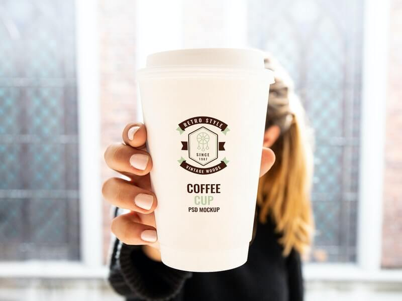 Free Woman Holding Cup Mockup PSD Template