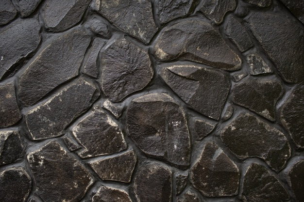 Black stone wall texture. bali. indonesia Free Photo