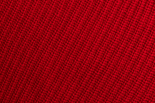Red knitted woolen fabric background or texture Premium Photo
