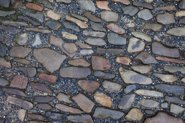 Texture of stone pavement tiles cobblestones bricks background Premium Photo
