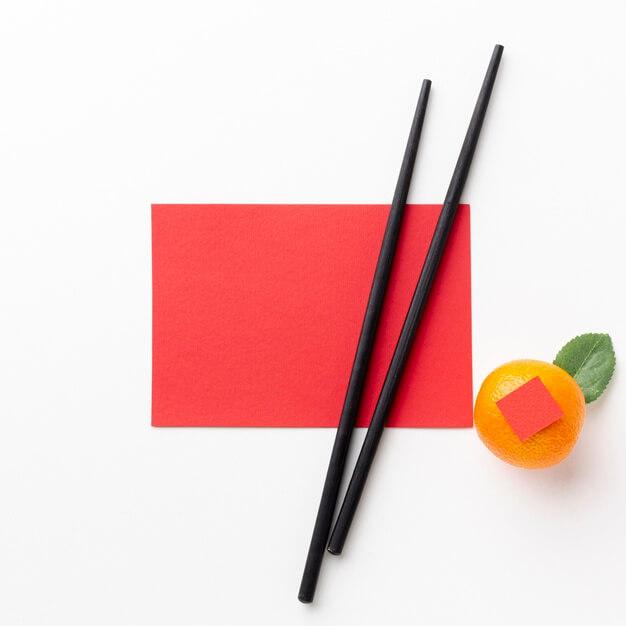 Chopsticks and card mock-up chinese new year Premium Photo