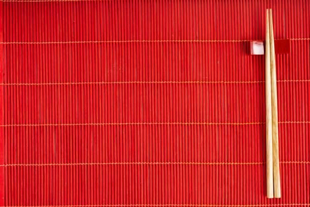 Chopsticks on the red bamboo mat