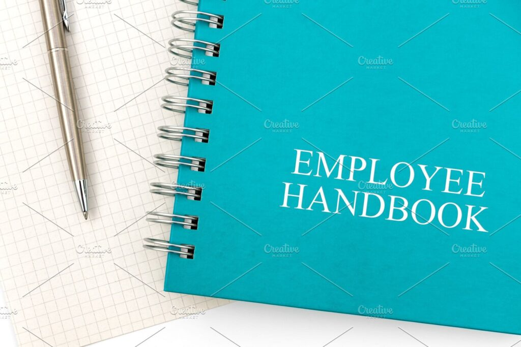 Employee handbook or manual stock photo containing book and business