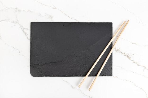 Empty black slate tray plate and chopsticks