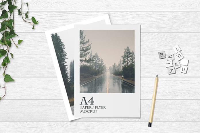 Free Photorealistic A4 Flyer On Table Mockup PSD Template