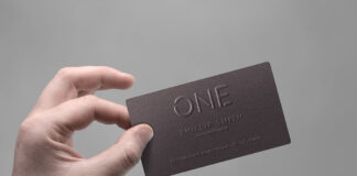 Free Realistic Business Card In Hand Mockup PSD Template