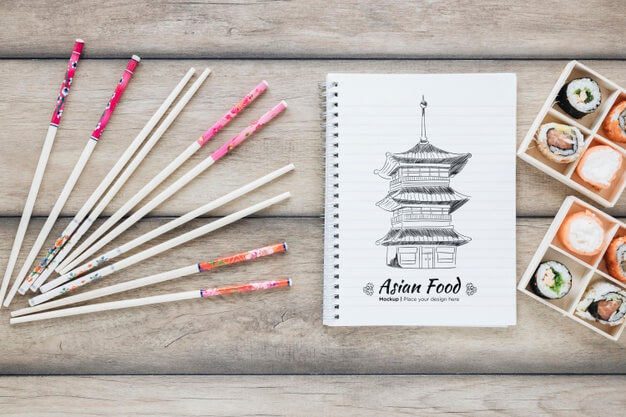 Top view sushi with chopsticks Free Psd