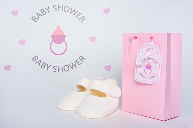 Front view of pink gift bag with shoes for baby shower Free Psd