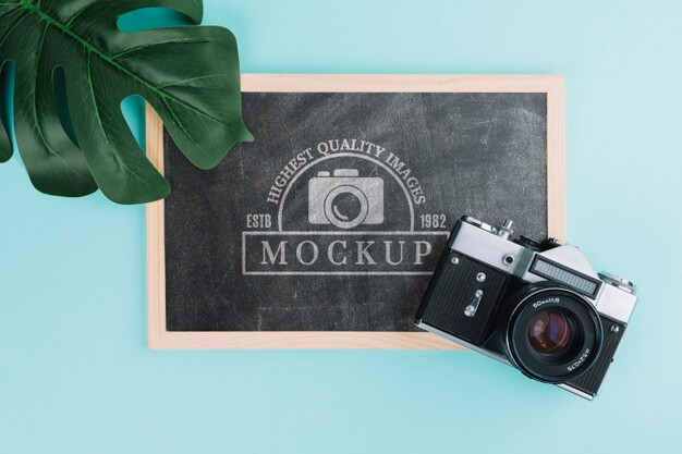 Top view photo camera with blackboard Free Psd