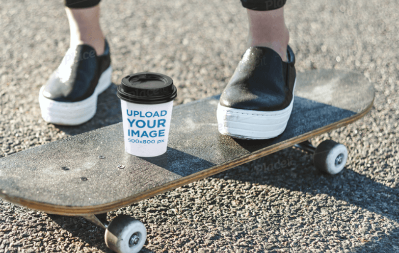 Paper Cup Mockup Featuring a Woman on a Skateboard
