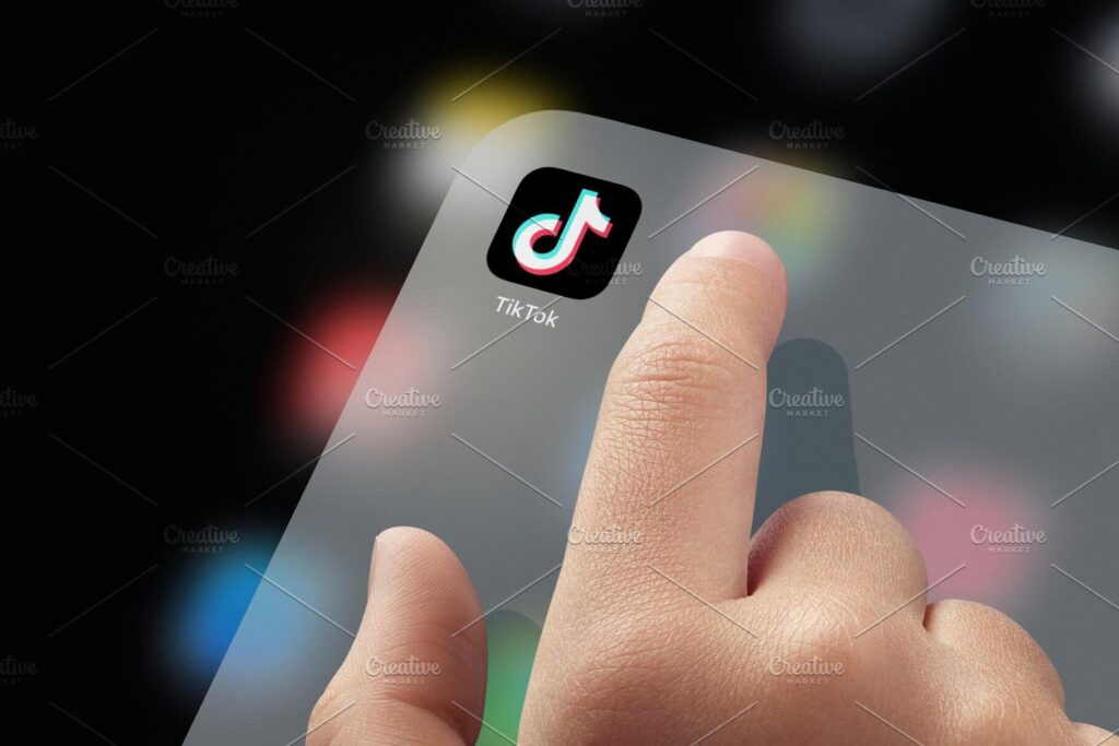 Child finger ready to click tiktok stock photo containing tiktok and tik (1)